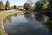 Village duck pond and historic house Urchfont Wiltshire England