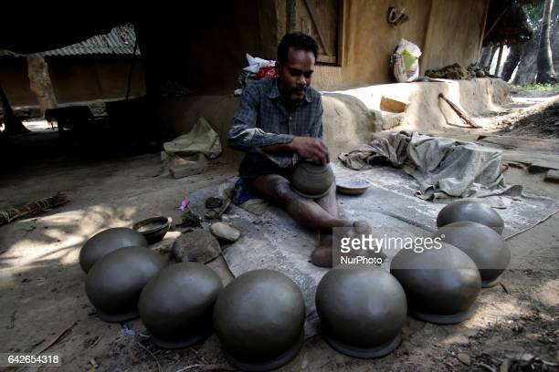 A village living potter prepares earthen pots before to supply it to the nearest market for sale ahead of the summer season outskirts of the eastern...