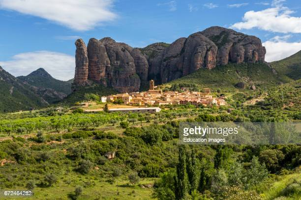 Village of AgÙero beneath the conglomerate rock formations of the Mallos de Riglos Huesca Province Aragon Spain The Mallos de Riglos are...