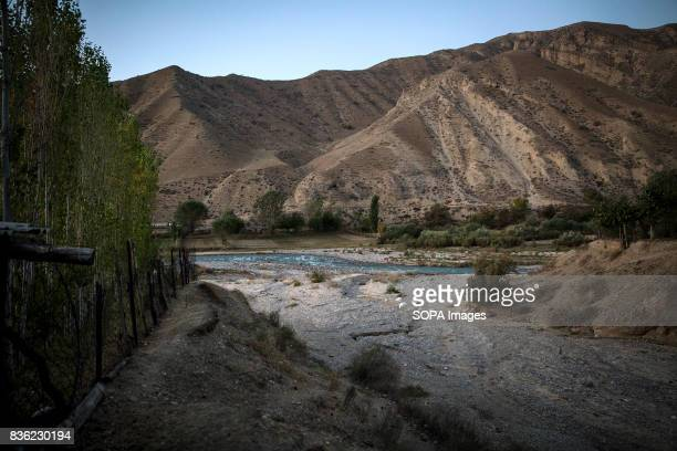 Village of Lyaily near Beshkent Kyrgyzstan where nearly all 300 families use water from the aryk an irrigation canal The water they drink is...