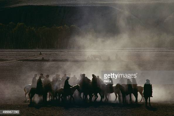 1990 Village of MugholHafez Badakhshan Afghanistan A few moments before the melee of men and animals known as the game of Buzkashi The game is played...