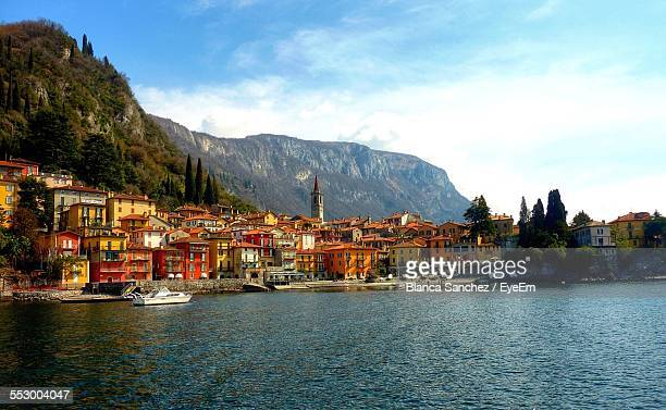 Village On Shores Of Lake Como With Mountains In The Background
