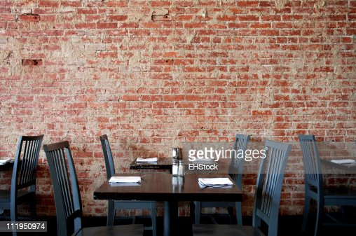 Village Pub Brick Wall with Tables and Chairs