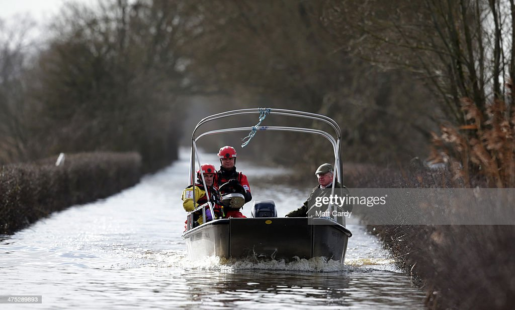 A village resident uses the humanitarian boat operated by a crew from Devon and Somerset fire service to cross from the still flood stricken village of Muchelney which, as of today, has been cut off by flood water for eight weeks, on the Somerset Levels on February 27, 2014 in Somerset, England. According to the Met Office, England and Wales have experienced their wettest winter since records began in 1766, with parts of flood-hit southern England having experienced 83% more rain than average.