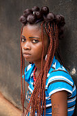 Village scene with portrait of young woman Jeneine in the Akato Viepe Village of the Ewe tribe near Lome Togo