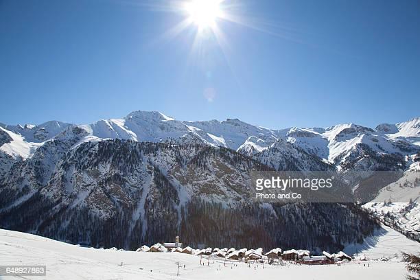 Village steeple, snowy mountain