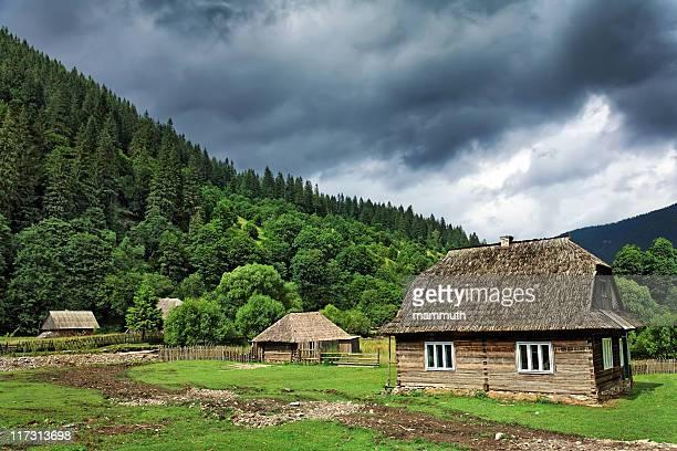 village under heavy clouds