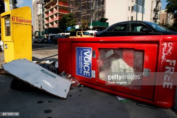 Village Voice newspaper stand lays on the ground next to garbage in the East Village neighborhood in Manhattan August 22 2017 The Village Voice one...