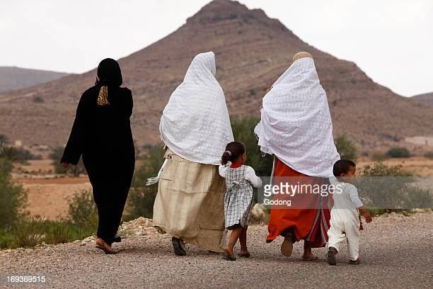 Village women and children walking on a country road Tunisia