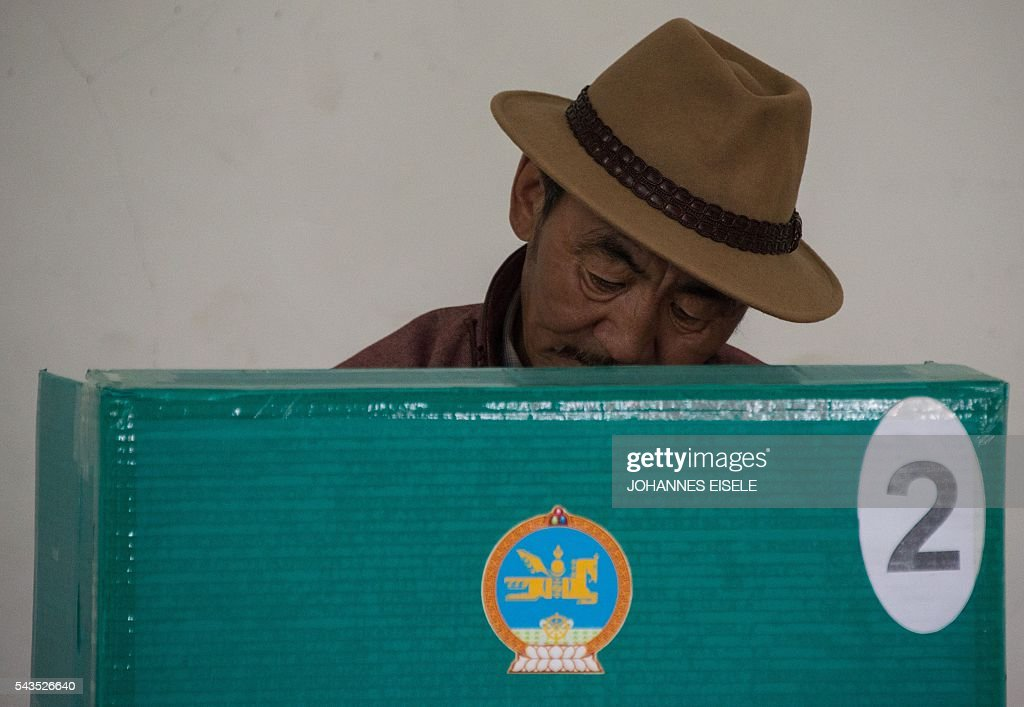 A villager casts his vote for the parliamentary elections at a polling station in Mandalgovi in the middle of Gobi province on June 29, 2016. Mongolians went to the polls across their sprawling, sparsely-populated country on June 29 as it struggles to benefit from its vast natural resources amid disputes over foreign investment and slumping demand from neighbouring China. EISELE