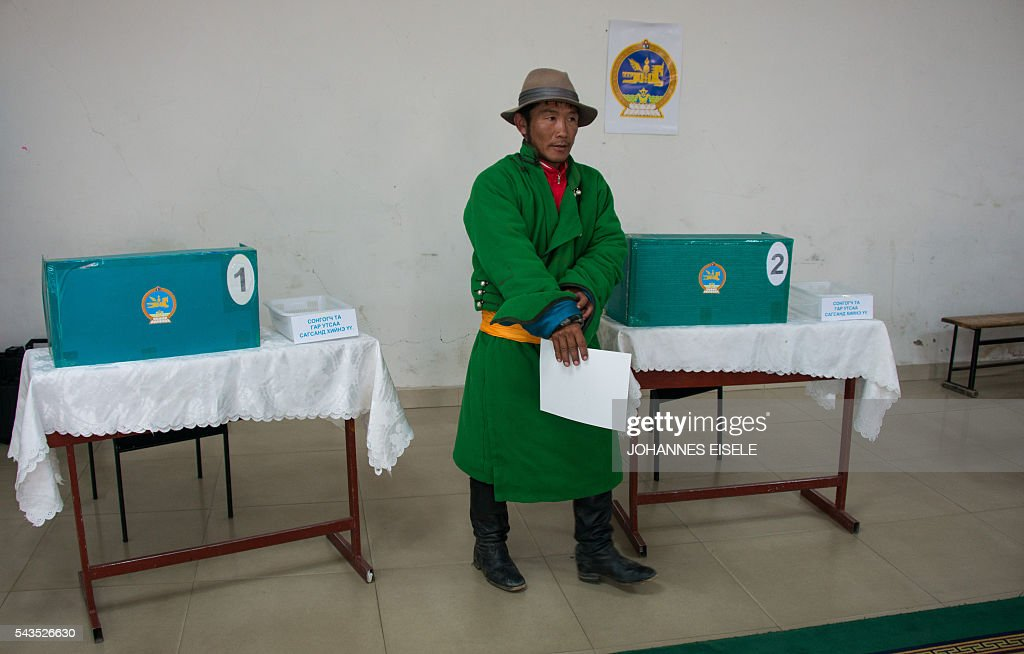 A villager casts his vote in the parliamentary elections at a polling station in Mandalgovi in the middle of Gobi province on June 29, 2016. Mongolians went to the polls across their sprawling, sparsely-populated country on June 29 as it struggles to benefit from its vast natural resources amid disputes over foreign investment and slumping demand from neighbouring China. EISELE