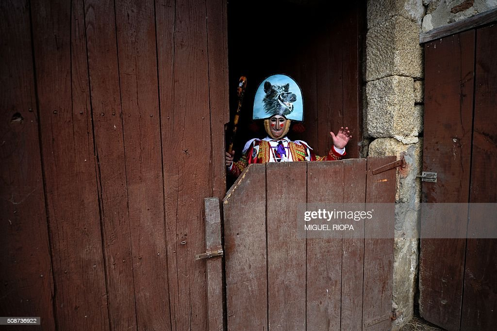 A villager dressed as a 'Felo' poses during the traditional and ancestral carnival close to the village of Maceda northwestern Spain on February 6, 2016. The 'Felos ' represent anarchic and rebellious spirits meant to instill fear into anyone who approaches them and are the 'authority' during the week of Carnival, meaning they can break the rules.The mask represents virility. AFP PHOTO/ MIGUEL RIOPA / AFP / MIGUEL RIOPA