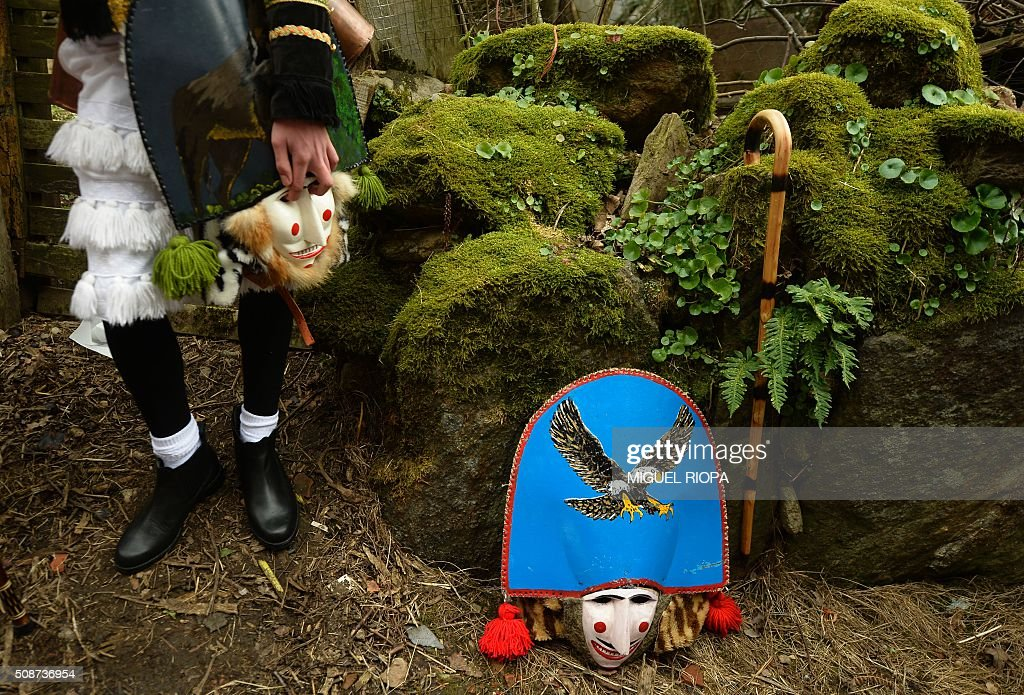 A villager dressed as a 'Felo' stands during the traditional and ancestral carnival close the village of Maceda, northwestern Spain, on February 6, 2016. The 'Felos ' represent anarchic and rebellious spirits meant to instill fear into anyone who approaches them and are the 'authority' during the week of Carnival, meaning they can break the rules.The mask represents virility. AFP PHOTO/ MIGUEL RIOPA / AFP / MIGUEL RIOPA