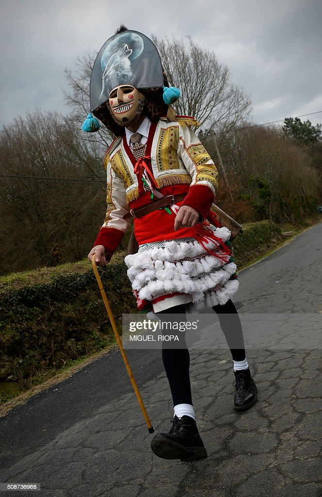 A villager dressed as a 'Felo' walks during the traditional and ancestral carnival close the village of Maceda, northwestern Spain, on February 6, 2016. The 'Felos ' represent anarchic and rebellious spirits meant to instill fear into anyone who approaches them and are the 'authority' during the week of Carnival, meaning they can break the rules.The mask represents virility. AFP PHOTO/ MIGUEL RIOPA / AFP / MIGUEL RIOPA
