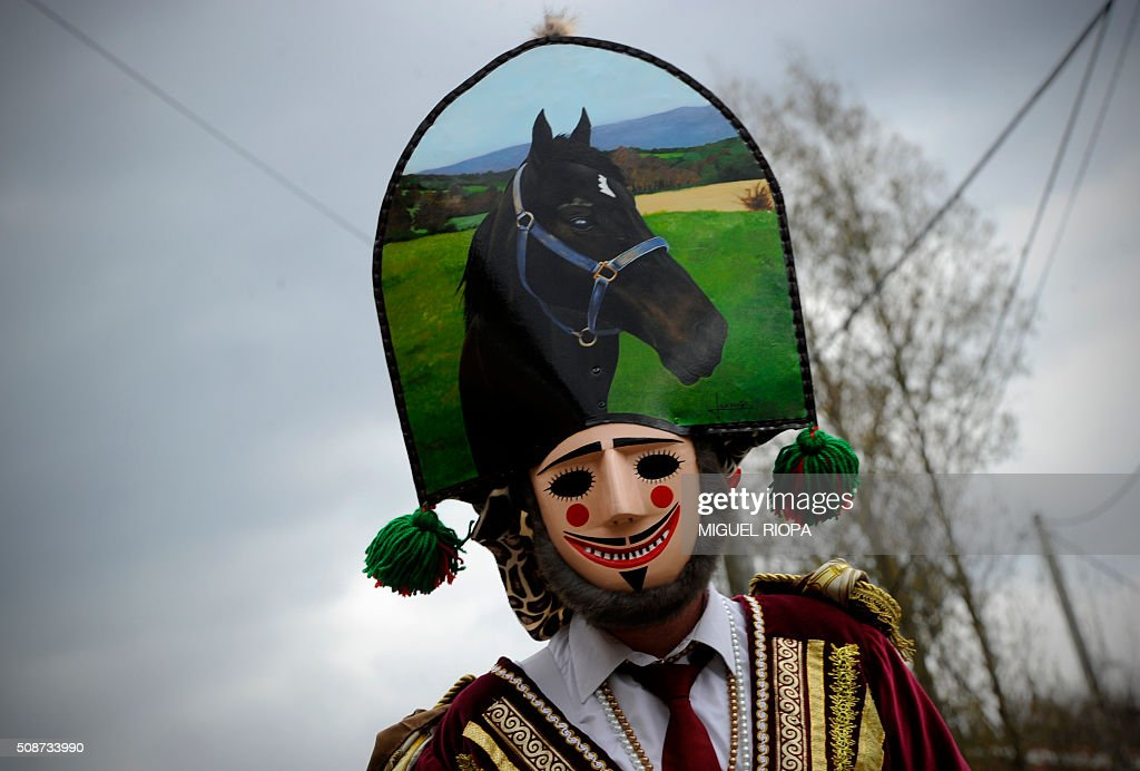 A villager dressed as a 'Felos' parades during the traditional and ancestral carnival close to the village of Maceda northwestern Spain on February 6, 2016. The 'Felos ' represent anarchic and rebellious spirits meant to instill fear into anyone who approaches them and are the 'authority' during the week of Carnival, meaning they can break the rules.The mask represents virility. AFP PHOTO/ MIGUEL RIOPA / AFP / MIGUEL RIOPA