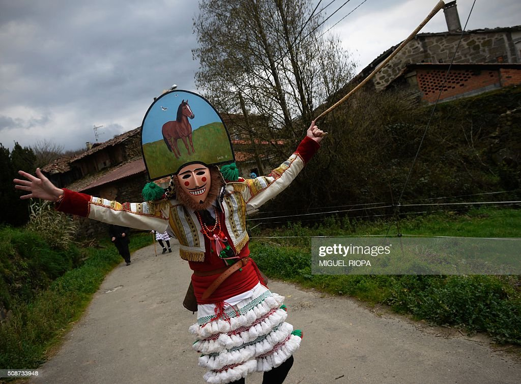 A villager dressed as a 'Felos' stands during the traditional and ancestral carnival close to the village of Maceda northwestern Spain on February 6, 2016. The 'Felos ' represent anarchic and rebellious spirits meant to instill fear into anyone who approaches them and are the 'authority' during the week of Carnival, meaning they can break the rules.The mask represents virility. AFP PHOTO/ MIGUEL RIOPA / AFP / MIGUEL RIOPA
