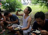 A villager drinks beer in primary school on July 14 2016 in Wuhan Hubei Province China The villagers moved into the primary school to avoid flooding...