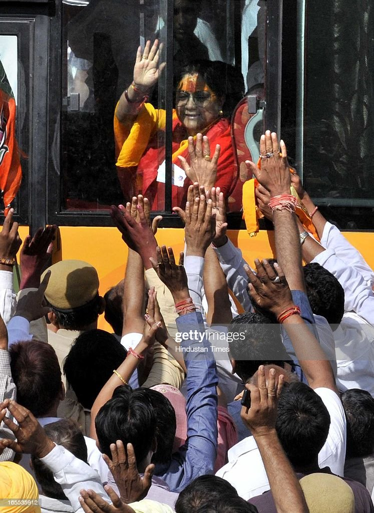 Villager greet Former Rajasthan CM and state BJP president Vasundhara Raje who started her Suraj Sankalp Yatra at Charbhuja village, on April 4, 2013 in Rajasamand, India. The Rajasthan assembly elections are due later this year.