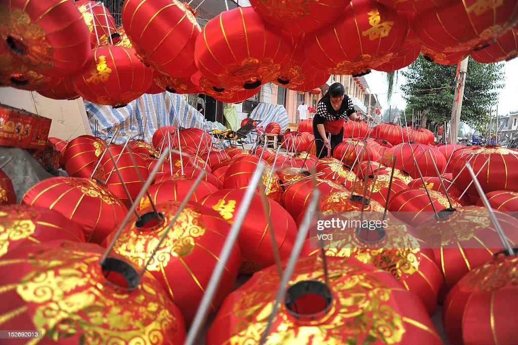 A villager prepares red lanterns at a lantern workshop, in Zhao Village which is known as 'lantern village' before National Day on September 23, 2012 in Yuncheng, China. China's national day is celebrated every year on October 1.