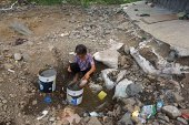 A villager retrieves water from the ground on August 4 2014 in Luoyang Henan Province in China Henan's Song County is currently suffering from...