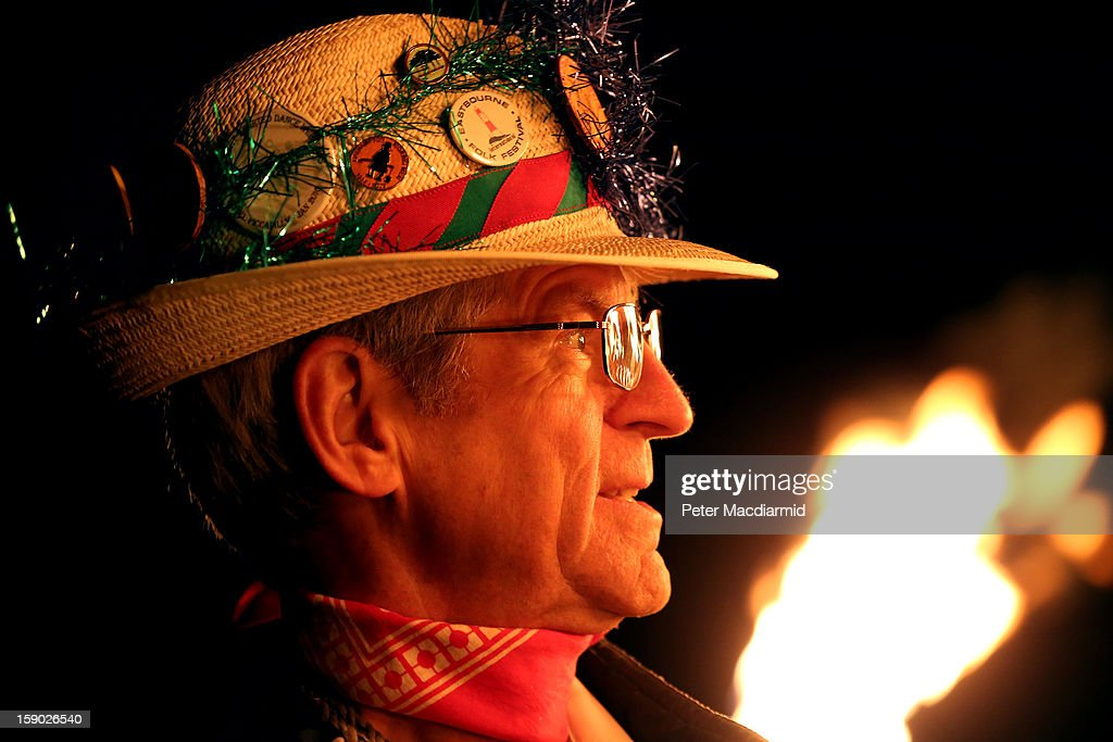A villager watches the Apple Howling ceremony at Old Mill Farm on January 5, 2013 in Bolney, England. In this ancient ritual villagers surround the oldest and largest tree in the orchard and evil spirits are driven out and good spirits are encouraged to produce a bountiful apple crop for the following year's cider drink.