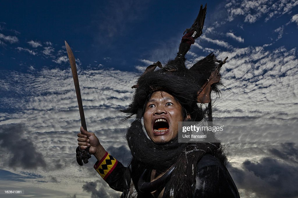 A villager wearing traditional war dress known as leama poses in Bawomataluo village on February 22, 2013 in Nias Island, Indonesia. Stone Jumping is a traditional ritual, with locals leaping over large stone towers, which in the past resulted in serious injury and death. Stone jumping in Nias Island was originally a tradition born of the habit of inter tribal fighting on the island of Nias.