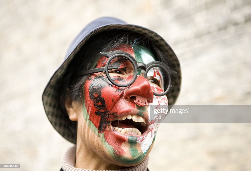 A villager with a painted face attends a Lantern Festival celebration on February 6, 2012 in Jinping County, Guizhou Province of China. The Lantern Festival, which falls on the 15th day of the first month of the Lunar New Year, takes place on February 6th.