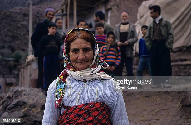 A villager woman with hair died in Henna and colorfully dressed seen in a village near RudbarIran on 29th May 1995