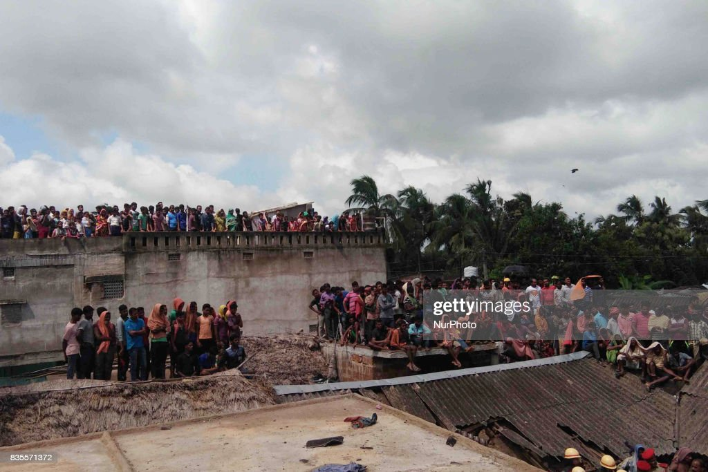 Villagers and onlookers stand near the spot of a crackers making unit explosion as rescue works going on at Siko village of Khorda district in the eastern Indian state Odisha on 19 August 2017. At least Five people killed in this explosion today morning as they are making fire crackers crackers ahead of the Diwali festival in illegally.