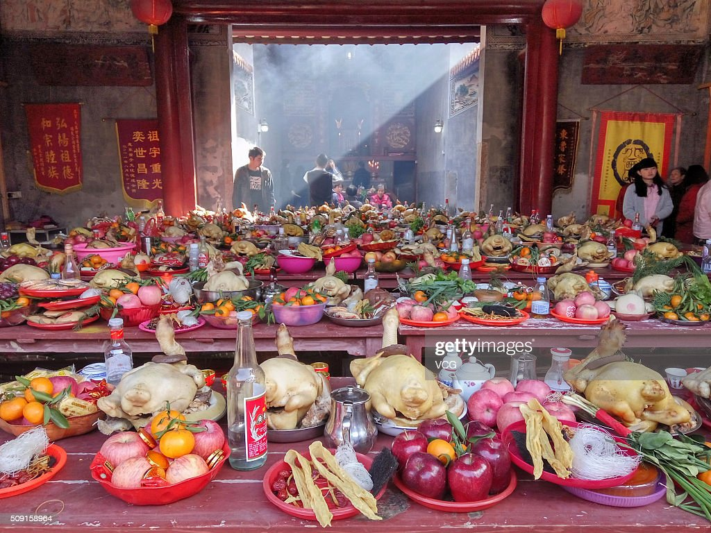 Villagers arrange a grand feast to worship ancestors on first day of new Year of Monkey at Dawan Village of Pingshan New Area on February 9, 2016 in Shenzhen, Guangdong Province of China. The ritual of ancestor worship here has a history of more than three hundred years that the sacrifice ceremony to pray for blessings.