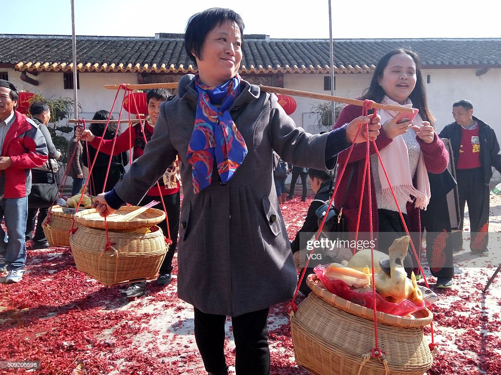Villagers arrange grand feast to worship ancestors on first day of new Year of Monkey at Dawan Village of Pingshan New Area on February 9, 2016 in Shenzhen, Guangdong Province of China. The ritual of ancestor worship here has a history of more than three hundred years that the sacrifice ceremony to pray for blessings.