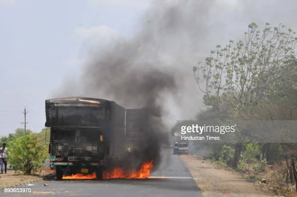 Villagers burn vehicles and staging a 'chakkajam' on MhowNeemuch highway with the body of Abhishek Patidar who was killed in police firing during...