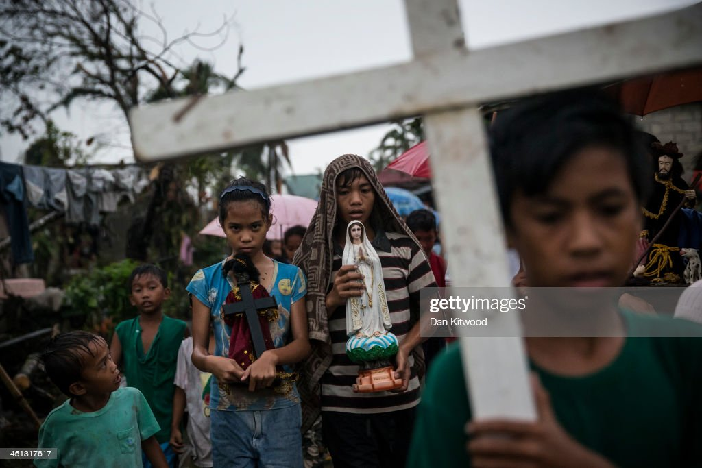 Villagers carry religious statues during a procession before taking part in a Latin mass ceremony at a local Chapel in Santa Rita township on November 22, 2013 in Eastern Samar, Philippines. Typhoon Haiyan which ripped through Philippines over a week ago has been described as one of the most powerful typhoons ever to hit land, leaving thousands dead and hundreds of thousands homeless. Countries all over the world have pledged relief aid to help support those affected by the typhoon however damage to the airport and roads have made moving the aid into the most affected areas very difficult. With dead bodies left out in the open air and very limited food, water and shelter, health concerns are growing.