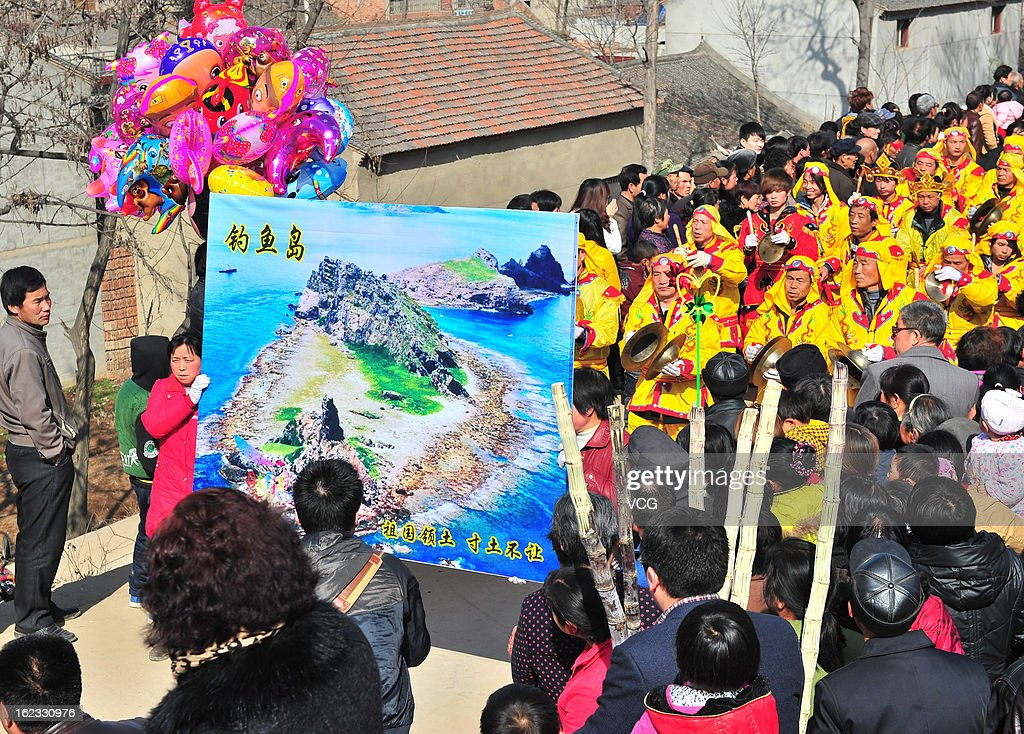 Villagers carrying a picture of Diaoyu islands parade in Longqu village during a Spring Festival celebration on February 22, 2013 in Xi an, China. The Chinese Lunar New Year of Snake also known as the Spring Festival, which is based on the Lunisolar Chinese calendar, is celebrated from the first day of the first month of the lunar year and ends with Lantern Festival on the Fifteenth day.