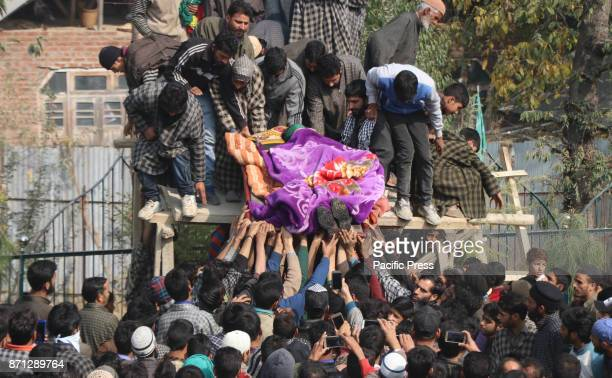 Villagers carrying the body of a slain local militant Waseem Ahmad on Tuesday November 07 2017 who was killed in an encounter that raged between the...