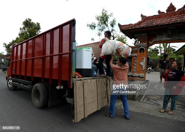 Villagers evacuate during the raised alert levels for the volcano on Mount Agung at Rendang subdistrict in Klungkung regency on Bali island on...