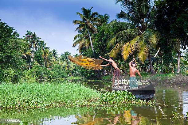 Villagers fishing in backwater canals around Kumarakom Village.