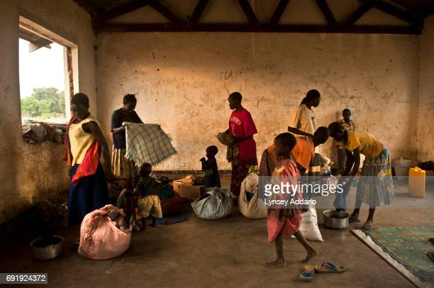 Villagers from Kansuk and Rodo districts take shelter in a school less than a week after their villages were attacked and their homes were looted by...
