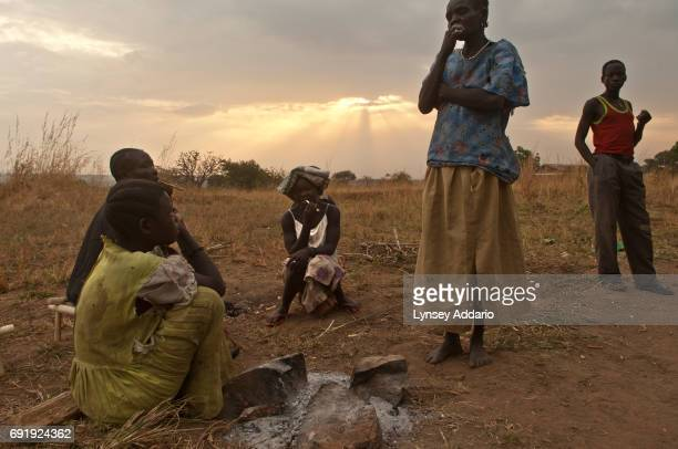 Villagers from Kansuk and Rodo districts take shelter outside of a school less than a week after their villages were attacked and their homes were...