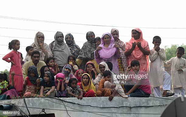 Villagers gather during the visit of JamaateIslami' party leader Siraj ul Haq in Hussain Khanwala village some 55 kms southwest of Lahore on August 9...