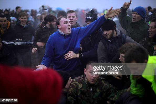 Villagers get caught in the sway as they battle for the Haxey Hood at Haxey Village on January 6 2017 in Doncaster England The origins of the ancient...