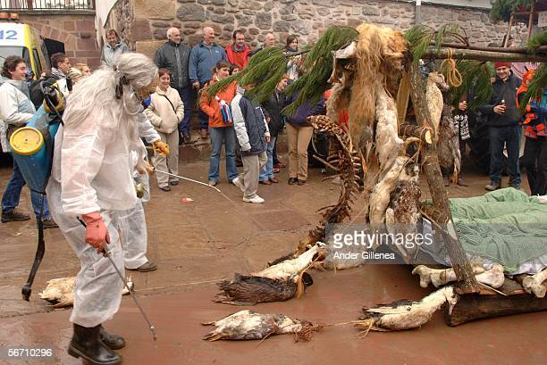 Villagers in disguise as part of a float representing the 'Bird flu' sickness perform during the celebration of an ancient traditional carnival...