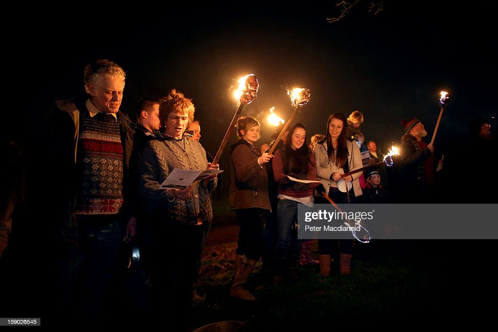 Villagers join in the singing of the wassail song during the Apple Howling ceremony at Old Mill Farm on January 5, 2013 in Bolney, England. In this ancient ritual villagers surround the oldest and largest tree in the orchard and evil spirits are driven out and good spirits are encouraged to produce a bountiful apple crop for the following year's cider drink.