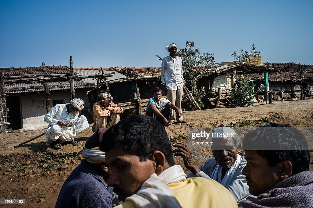 Villagers meet in Makhla village, Maharashtra, India, on Thursday, Nov. 15, 2012. The Indian economy will expand 4.9 percent in 2012, the least in a decade, according to the International Monetary Fund. Photographer: Sanjit Das/Bloomberg via Getty Images