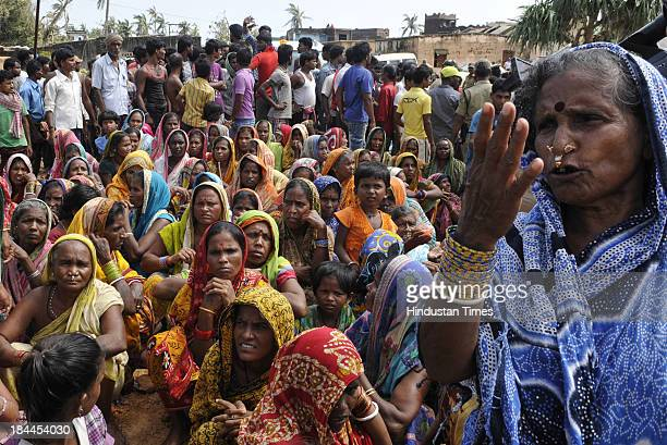 Villagers of Agasti Nuagaon of Ganjam District block the convoy of Odisha Chief Minister Naveen Patnaik during his visit to Phailin affected Ganjam...