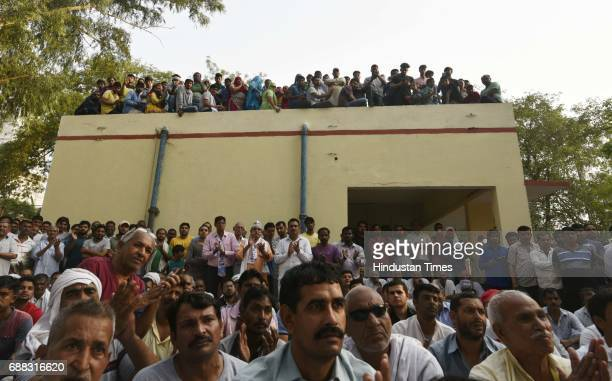 Villagers of Chawala listening to Delhi Chief Minister Arvind Kejriwal during a panchayat meeting in the Nazafgarh area on May 25 2017 in New Delhi...