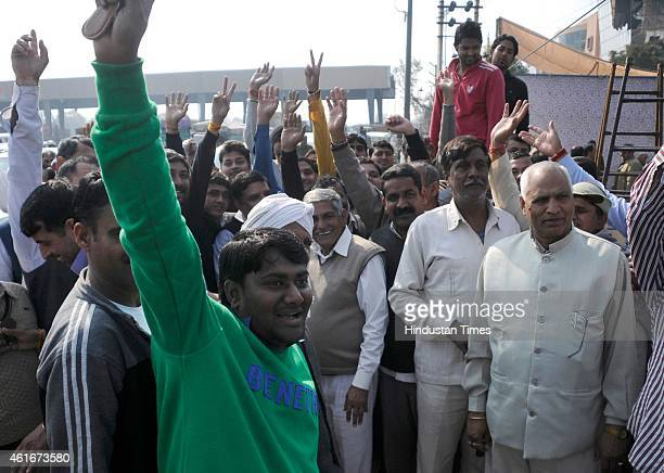 Villagers of eleven villages protested at Kherki Daula toll plaza demanding tollfree tags for their vehicles on January 17 2015 in Gurgaon India At...