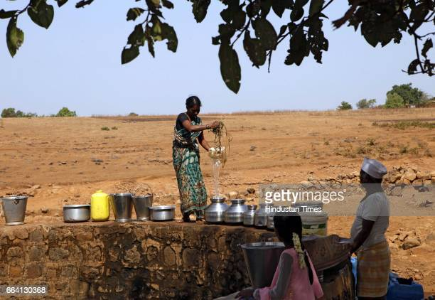 Villagers of Kogda village in Jawhar taluka gather at a well to fill water Water scarcity has hit the region with women having to walk several...