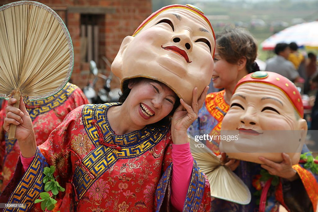 Villagers parade in Suntoupo village during the traditional festival known as Dragon Head Raising Day on March 13, 2013 in Nanning, China. Dragon Raises Head Day is celebrated on the second day of the second lunar month in China.