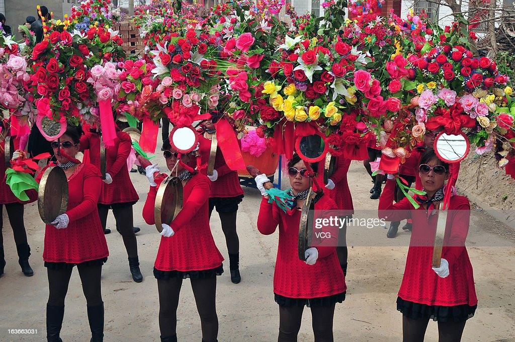 Villagers parade in Yangxian village during the traditional festival known as Dragon Head Raising Day on March 13, 2013 in Ruicheng County, China. Dragon Head Raising Day is celebrated on the second day of the second lunar month in China.